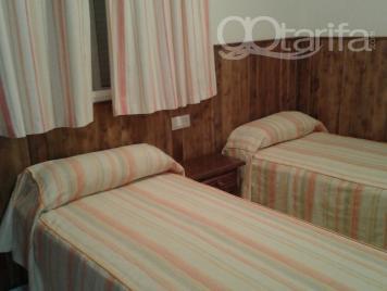 dormitorio dos camas de 90 cm.